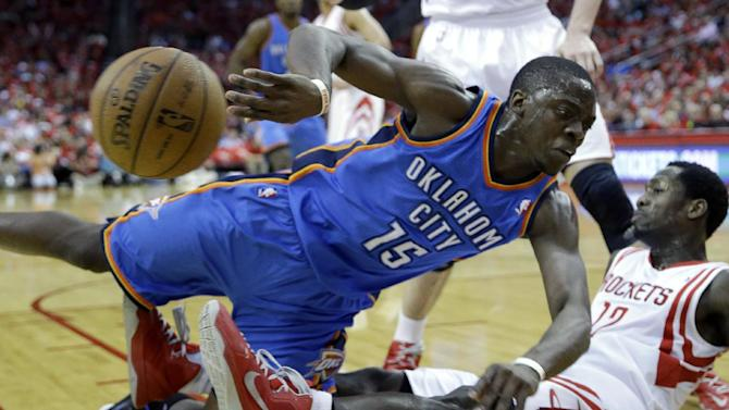 Oklahoma City Thunder's Reggie Jackson (15) falls onto Houston Rockets' Patrick Beverley (12) during the first quarter of Game 4 in their first-round NBA basketball playoff series Monday, April 29, 2013, in Houston. (AP Photo/David J. Phillip)
