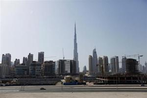Construction cranes are seen near Burj Khalifa in Dubai