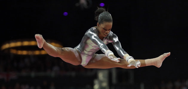 U.S. gymnast Gabrielle Douglas performs on the uneven bars during the artistic gymnastics women's apparatus finals at the 2012 Summer Olympics, Monday, Aug. 6, 2012, in London. (AP Photo/Gregory Bull)