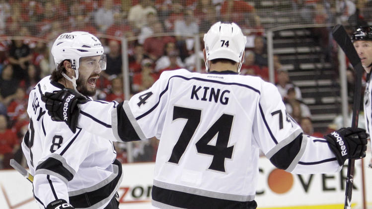 Los Angeles Kings' Drew Doughty, left, celebrates with teammate Dwight King after scoring a goal against the New Jersey Devils during the first period of Game 2 of the NHL hockey Stanley Cup finals on Saturday, June 2, 2012, in Newark, N.J. (AP Photo/Frank Franklin II)