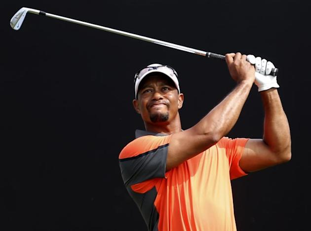 Tiger Woods tees a shot during the third round of the Dubai Desert Classic on February 1, 2014