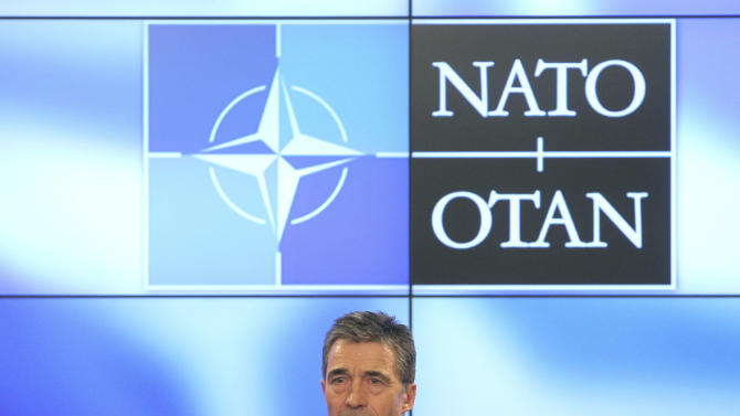 NATO Secretary General Anders Fogh Rasmussen addresses the media on his monthly media conference in Brussels, Monday, March 5, 2012. (AP Photo/Yves Logghe)