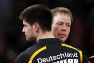 Patrick Baum of Germany (facing camera) passes his compatriot Dimitrij Ovtcharov after their men&#39;s singles fourth round match at the World Team Table Tennis Championships in Paris May 18, 2013. The 52nd edition of the World Table Tennis Championships gathers 829 athletes from 162 countries and runs from May 13 to May 20. REUTERS/Charles Platiau (FRANCE - Tags: SPORT TABLE TENNIS)