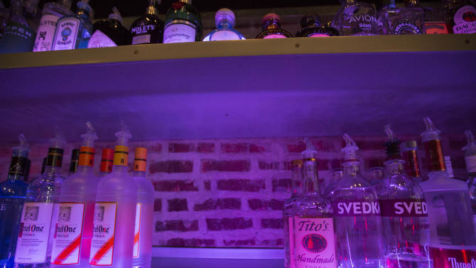 "An empty space on a liquor shelf where Russian vodka used to be located at The Sidetrack, a gay bar on the north side of Chicago, Monday, July 29, 2013. Many gay bars across North America have joined a campaign to stop selling Russian vodka due to anti-gay laws in Russia. The chief cause of the anger is a law signed by President Vladimir Putin last month that bans the ""propaganda of nontraditional sexual relations"" and imposes hefty fines for providing information about the gay community to minors or holding gay pride rallies. (AP Photo/Scott Eisen)"