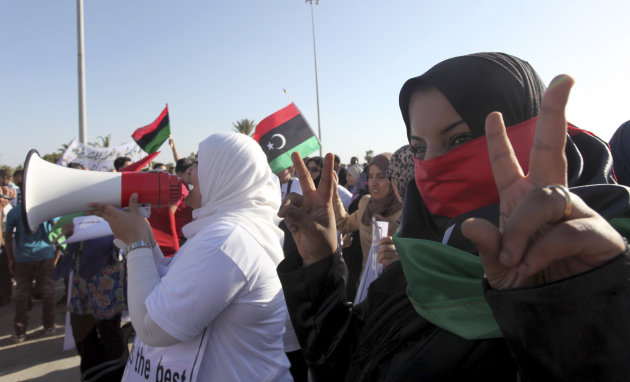 Libyan women protest against Ansar al-Shariah Brigades and other Islamic militias in front Tebesty Hotel, in Benghazi, Libya, Friday, Sept. 21, 2012. The attack that killed the U.S. ambassador and three other Americans has sparked a backlash among frustrated Libyans against the heavily armed gunmen, including Islamic extremists, who run rampant in their cities. More than 10,000 people poured into a main boulevard of Benghazi, demanding that militias disband as the public tries to do what Libya's weak central government has been unable to.(AP Photo/Mohammad Hannon)