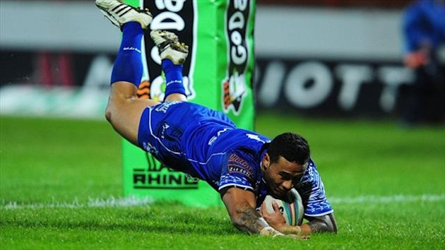 Samoa's Ben Roberts dives over to score a try during the 38-4 World Cup defeat of Papua New Guinea.