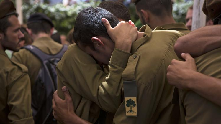 Israeli soldiers from Golani Brigade mourn during funeral for their fallen comrade in Jerusalem