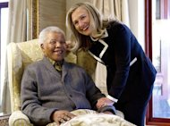 US Secretary of State Hillary Rodham Clinton meets Nelson Mandela, 94, former president of South Africa, at his home in Qunu, South Africa