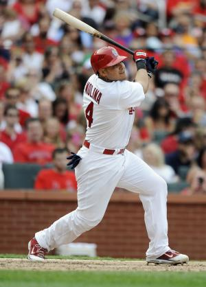 St. Louis Cardinals' Yadier Molina follows through on his two-run double against Pittsburgh Pirates' in the fifth inning in a baseball game Saturday, Aug. 18, 2012, in St. Louis. (AP Photo/Bill Boyce)