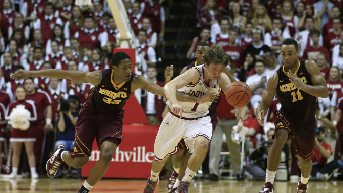Indiana's Jordan Hulls (1) is fouled by Minnesota's Rodney Williams (33) during the second half of an NCAA college basketball game Saturday, Jan. 12, 2013, in Bloomington, Ind. Indiana defeated Minnesota 88-81. (AP Photo/Darron Cummings)