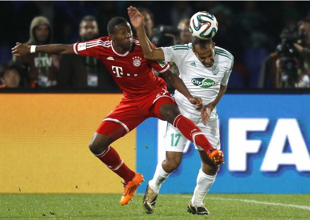 Rachid Soulaimani of Morocco's Raja Casablanca fights for the ball with David Alaba of Germany's Bayern Munich during their 2013 FIFA Club World Cup final soccer match at Marrakech stadium