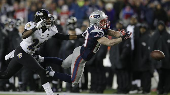 New England Patriots wide receiver Wes Welker (83) dives while being defended by Baltimore Ravens cornerback Corey Graham (24) during the first half of the NFL football AFC Championship football game in Foxborough, Mass., Sunday, Jan. 20, 2013. The pass was incomplete. (AP Photo/Elise Amendola)