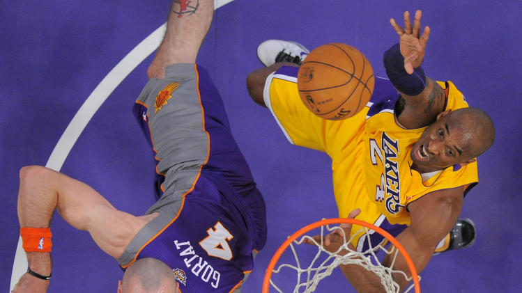 Los Angeles Lakers guard Kobe Bryant, right, puts up a shot as Phoenix Suns center Marcin Gortat, of Poland, defends during the first half of their NBA basketball game, Friday, Nov. 16, 2012, in Los Angeles. (AP Photo/Mark J. Terrill)