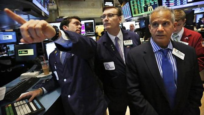 Specialist trader Joseph Dreyer (L) speaks with governor Patrick King (C) and NYSE managing director Rudy Mass (R) before opening a stock after the bell on the floor at the New York Stock Exchange, July 18, 2013. REUTERS/Brendan McDermid/Files