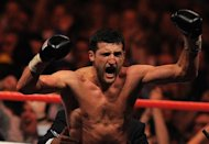 Britain's Carl Froch celebrates after beating Lucian Bute of Romania during their IBF super-middleweight title match in Nottingham