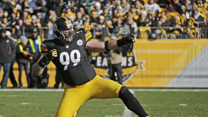 Pittsburgh Steelers defensive end Brett Keisel (99) celebrates after making a tackle against the Cincinnati Bengals in the first quarterof an NFL football game in Pittsburgh, Sunday, Dec. 23, 2012. Keisel was penalized for the celebration on the play. (AP Photo/Gene J. Puskar)