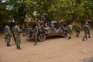 Malian soldiers enter the historic city of Timbuktu on January 28, 2013.