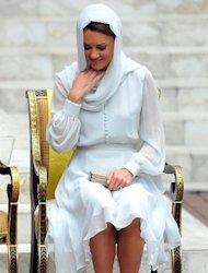 "Britain's Prince William's wife, Catherine, the Duchess of Cambridge adjusts her scarf outside a mosque in Kuala Lumpur on September 14. The British royal family have warned an Italian magazine that ""unjustifiable upset"" would be heaped on Catherine if it went ahead and printed topless photos of her."