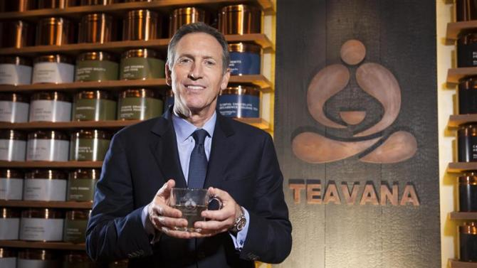 Schultz, chief executive of Starbucks, holds a cup of tea as he poses for a portrait at his new Teavana store in New York