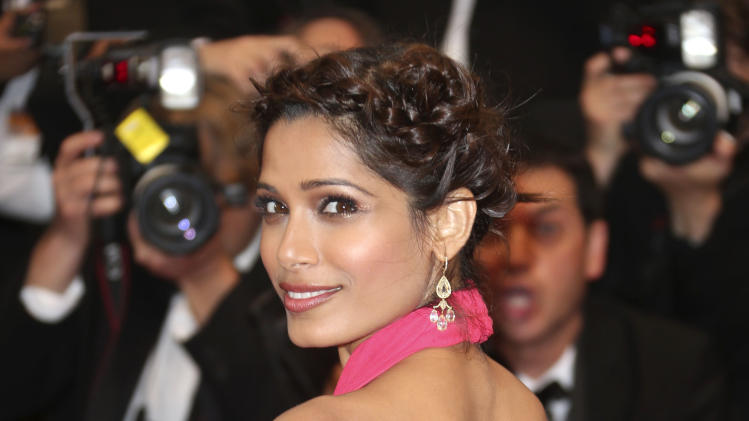 Actress Freida Pinto arrives for the opening ceremony and the screening of The Great Gatsby at the 66th international film festival, in Cannes, southern France, Wednesday, May 15, 2013. (Photo by Joel Ryan/Invision/AP)