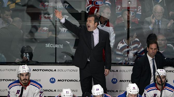 New York Rangers coach Alain Vigneault pulls his goaltender during the third period of Game 5 of the NHL hockey Stanley Cup playoffs Eastern Conference finals against the Montreal Canadiens, Tuesday, May 27, 2014, in Montreal. Montreal won 7-4