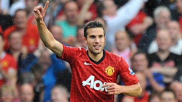 Manchester United's Robin van Persie celebrates after scoring his team's opening goal