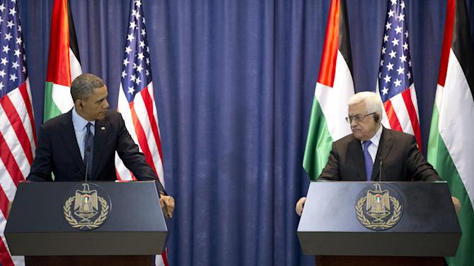 President Barack Obama, left, and Palestinian President Mahmoud Abbas, participate in a joint news conference at the Muqata Presidential Compound, in the West Bank town of Ramallah, Thursday, March 21, 2013. (AP Photo/Carolyn Kaster)