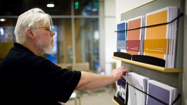 California state worker Curtis Walker looks over retirement plan brochures at the Calpers regional office in Sacramento