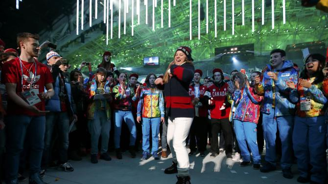 Athletes party on stage after the closing ceremony for the Sochi 2014 Winter Olympic Games