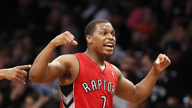 Toronto Raptors guard Kyle Lowry (7) reacts in waning minutes of the second half of Game 4 of an NBA basketball first-round playoff series against the Brooklyn Nets at the Barclays Center, Sunday, April 27, 2014, in New York. The Raptors evened the series at 2-2, defeating the Nets 87-79