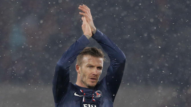 Paris Saint Germain's David Beckham applauds the crowd at the end of their League One soccer match against Marseille at Parc des Princes Stadium, in Paris, Sunday Feb. 24, 2013. Beckham made his Paris St Germain debut as Carlo Ancelotti's men took a potentially vital step towards claiming the Ligue 1 title. (AP Photo/Francois Mori)