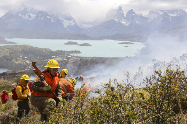 Firefighters work in an area of the Torres del Paine national park in Torres del Paine, Chile, Sunday Jan. 1, 2012. Firefighters are making progress against a major blaze that has burned at least 48 s