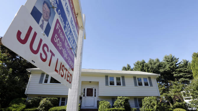 In this Wednesday, Sept. 18, 2013 photo a for sale sign hangs in front of a house in Walpole, Mass. U.S. home sales rose in August 2013 to the highest level since February 2007 as buyers rushed to close deals before interest rates rise further.( AP Photo/Steven Senne)