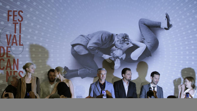 Director Baz Luhrmann, centre, poses for photographers along with actors from left, Elizabeth Debicki, Joel Edgerton, Carey Mulligan, Leonardo DiCaprio, Tobey Maguire, and Isla Fischer prior to the press conference for the film The Great Gatsby at the 66th international film festival, in Cannes, southern France, Wednesday, May 15, 2013. From right is Isla Fischer, Tobey Maguire and Leonardo DiCaprio. (AP Photo/Virginia Mayo)