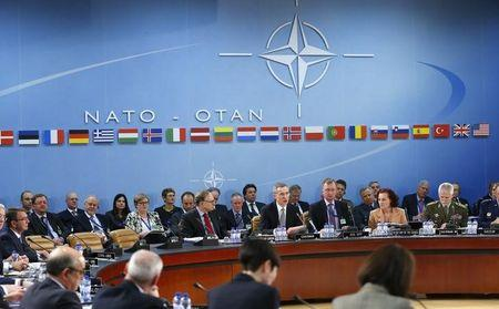 NATO agrees Russian deterrent but avoids Cold War footing