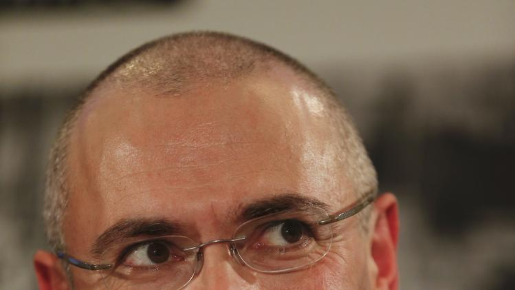 Freed Russian former oil tycoon Khodorkovsky reacts during his news conference in the Museum Haus am Checkpoint Charlie in Berlin