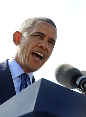 President Barack Obama speaks to the media at the Washington Irving Boat Club in Tarrytown, N.Y., Wednesday, May 14, 2014. The President spoke about the need for Congress to fund road and bridge improvements across the nation. (AP Photo/Journal News, Seth Harrison, Pool)