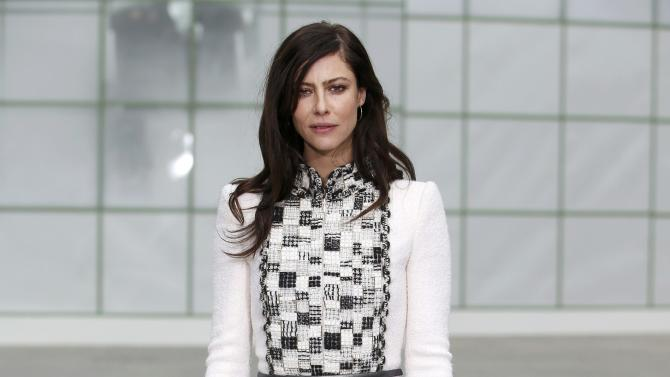 French actress Anna Mouglalis poses during a photocall before German designer Karl Lagerfeld Haute Couture Spring Summer 2015 fashion show for French fashion house Chanel in Paris