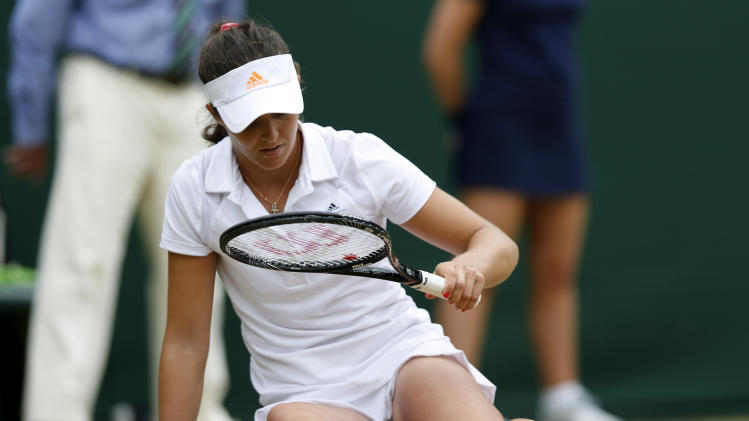 Laura Robson of Britain slips as she plays Kaia Kanepi of Estonia during a Women's singles match at the All England Lawn Tennis Championships in Wimbledon, London, Monday, July 1, 2013. (AP Photo/Sang Tan)