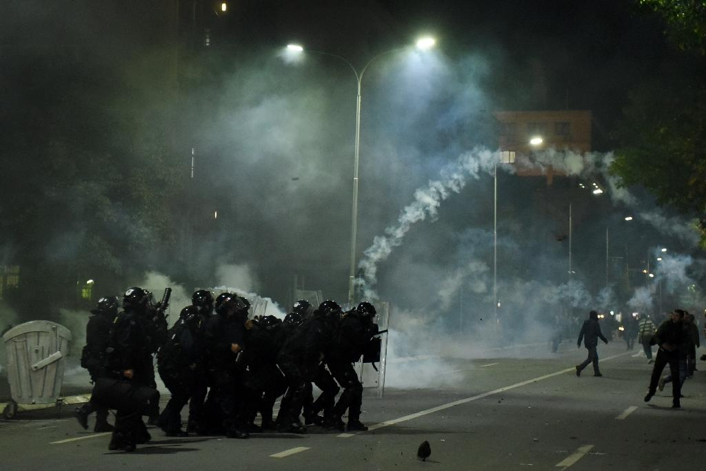 Tear gas and stone-throwing as police question Kosovo MP