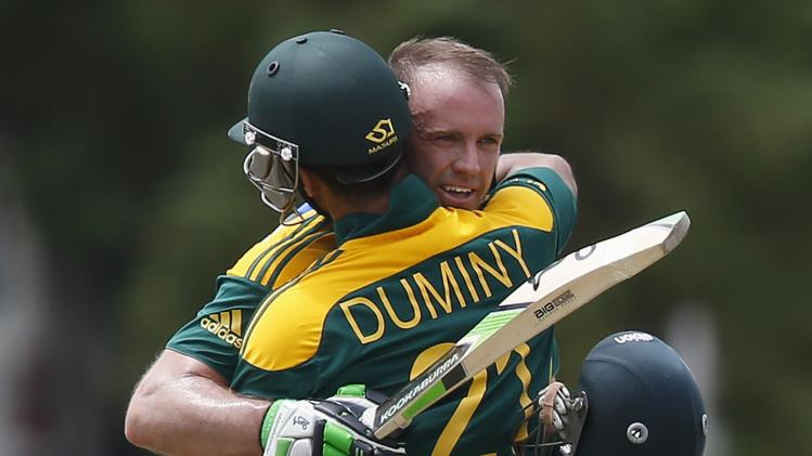 South Africa's captain de Villiers is congratulated by teammate Duminy during their final One Day International cricket match against Sri Lanka in Hambantota