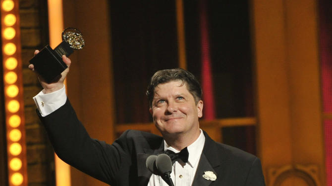 Michael McGrath accepts the award for best performance by an actor in a featured role in a musical at the 66th Annual Tony Awards on Sunday June 10, 2012, in New York. (Photo by Charles Sykes /Invision/AP)