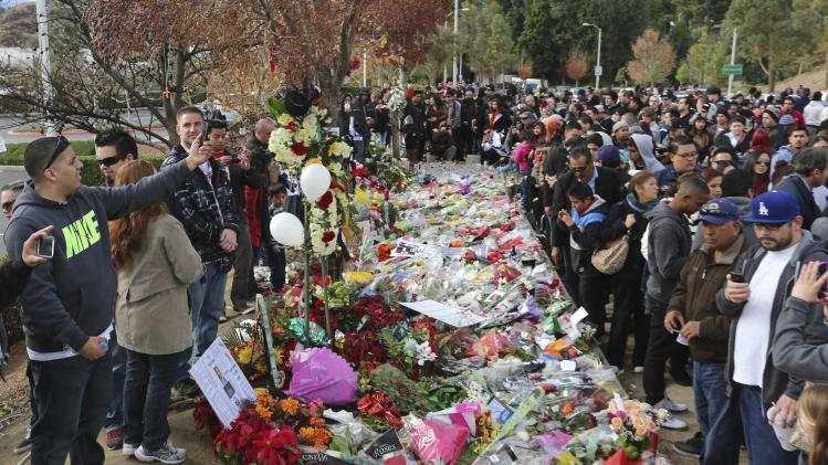 "Crowds gather at an unofficial memorial event for ""Fast & Furious"" star Walker in Santa Clarita"