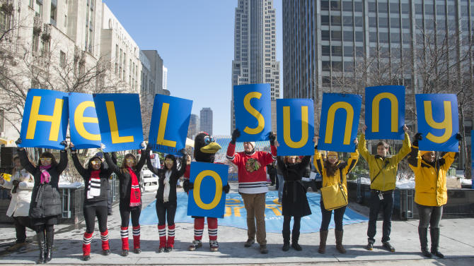 IMAGE DISTRIBUTED FOR GREATER FORT LAUDERDALE - Goodbye chilly. HELLO SUNNY, as the Greater Fort Lauderdale Convention & Visitors Bureau says goodbye chilly, Hello Sunny today on Michigan Avenue in Chicago with their Hello Sunny campaign, Wednesday Feb. 6, 2013. The CVB's promotion encourages Chicagoans and the nation to enjoy the warm Greater Fort Lauderdale sunshine. Visit www.sunny.org/defrost for a chance to win a Fort Lauderdale beach getaway. (Peter Barreras/Invision for Greater Fort Lauderdale/AP Images)