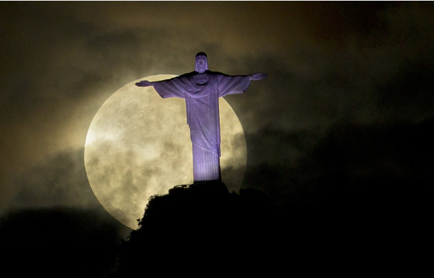 "A ""supermoon"" is seen behind the Christ the Redeemer statue in Rio de Janeiro, Sunday, May 6, 2012. A supermoon is the coincidence of a full moon (or a new moon) with the closest approach the moon mak"