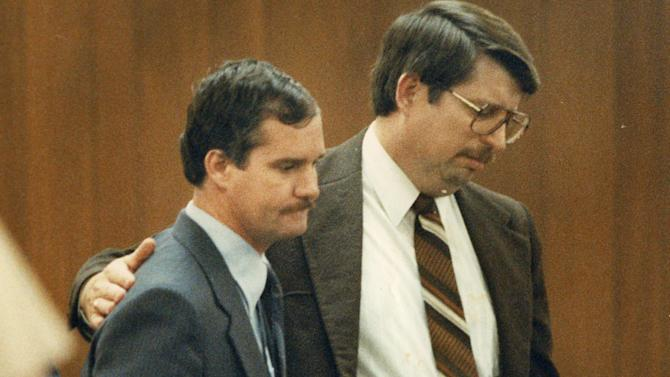 In this 1988 photo, Edward Graf, left, is consoled by Don Youngblood, a private investigator who worked with Graf's attorneys, after a jury sentenced Graf to life in prison for killing his two stepsons by locking them in a backyard shed and setting it on fire, in Waco Texas. Two investigators used photos of the shed's remains to persuade jurors that Graf had started the fire intentionally, killing Clare Bradburn's sons. Authorities in Texas and in other states are beginning to re-examine old arson cases in which defendants may have been convicted with questionable scientific evidence. (AP Photo/Waco Tribune Herald, Rod Aydelotte)