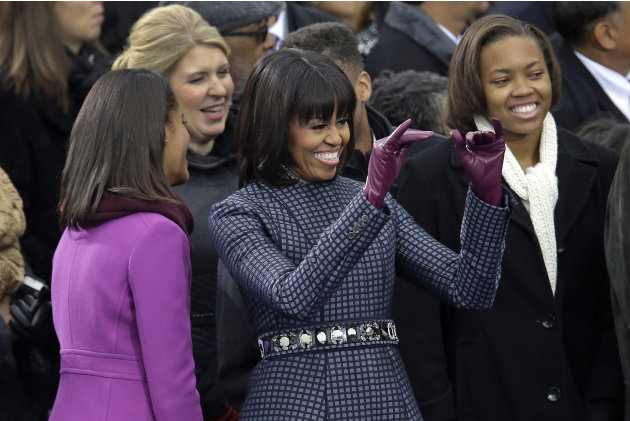 First Lady Michelle waves across the aisle at the ceremonial swearing-in for President Barack Obama at the U.S. Capitol during the 57th Presidential Inauguration in Washington, Monday, Jan. 21, 2013.
