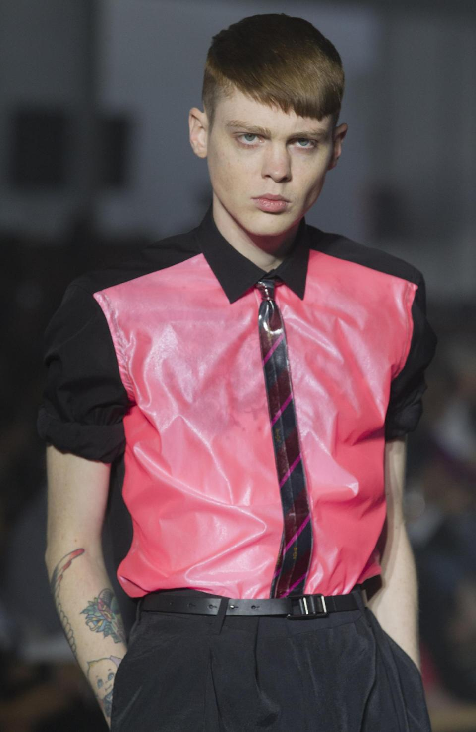 A model wears a creation by Israeli fashion designer Alber Elbaz during his  Men's Spring-Summer 2013 collection, for Lanvin fashion house in Paris, France, Sunday, July 1, 2012. (AP Photo/Jacques Brinon)