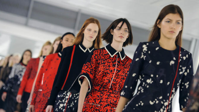 Models display designs,  during the Preen catwalk show on day three of London Fashion Week, at the Heron Tower, London,  Sunday Feb. 17, 2013. (AP Photo/Dominic Lipinski/PA) UNITED KINGDOM OUT