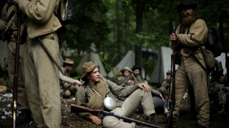 Members of the 1st Tennessee wait to take part in in a demonstration of a battle during ongoing activities commemorating the 150th anniversary of the Battle of Gettysburg, Friday, June 28, 2013, at at Bushey Farm in Gettysburg, Pa. Union forces turned away a Confederate advance in the pivotal battle of the Civil War fought July 1-3, 1863, which was also the war's bloodiest conflict with more than 51,000 casualties. (AP Photo/Matt Rourke)